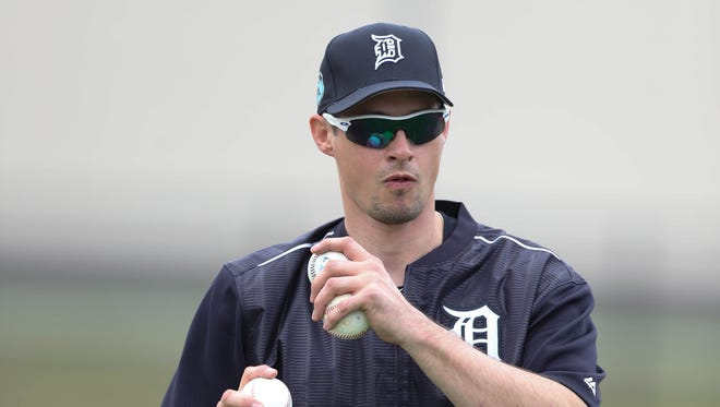 Former Tiger Don Kelly pitches batting practice during the first full team workout in spring training on Feb. 18, 2017, at Publix Field at Joker Marchant Stadium in Lakeland, Fla.