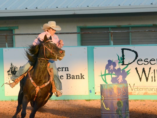Madison Rinnie maneuvers around a barrel in Thursday's Amateur Barrel Racing Qualifier at the Eddy County Sheriff's Posse Arena.