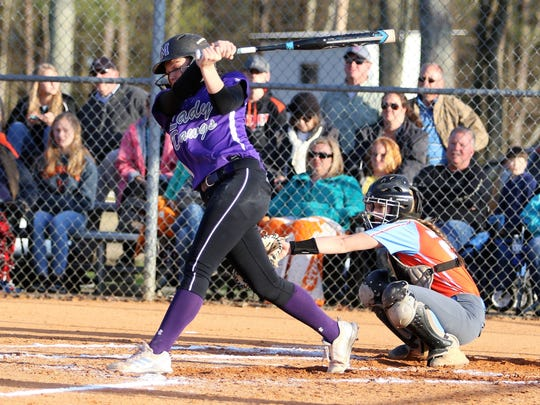 Milan's Kendall Westbrooks swings at a pitch during the Lady Bulldogs' 7-5 win over South Gibson on April 5, 2018.