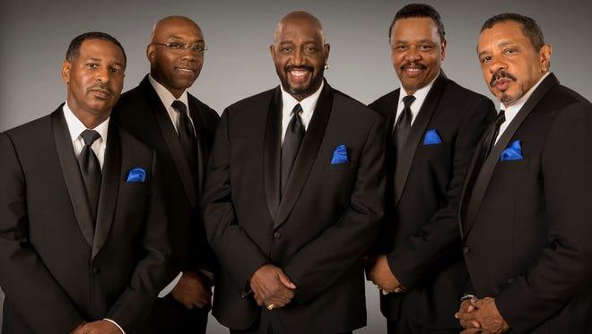 Otis Williams (center) and the Temptations