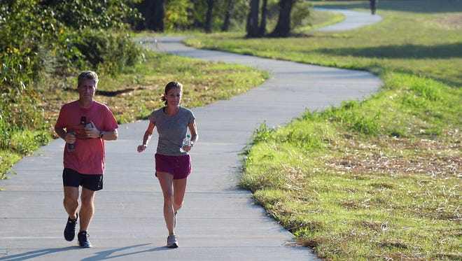 Runners use the new greenway trail along the Harpeth River in downtown Franklin on Oct. 5, 2016. The new trail connects to the existing Chestnut Bend neighborhood trail.