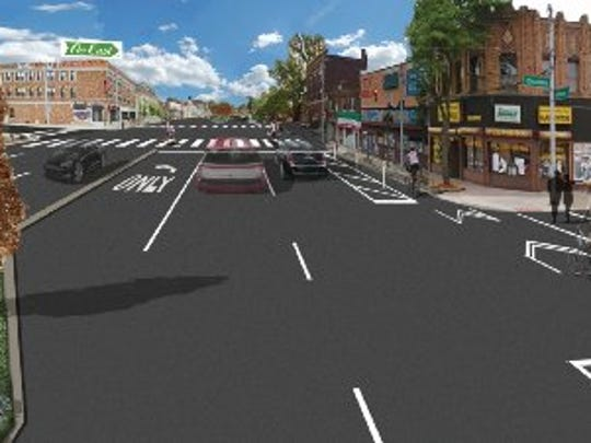 Rendering of what East Jefferson Avenue will look like with protected bicycle lanes installed