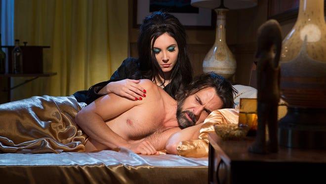 "Elaine (Samantha Robinson) comforts Wayne (Jeffrey Vincent Parise) in ""The Love Witch."""