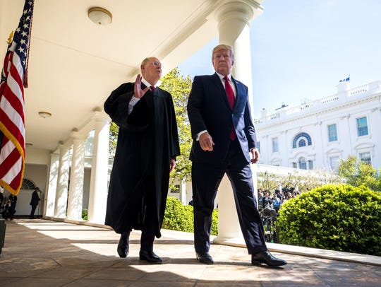 Justice Anthony Kennedy and President Donald Trump
