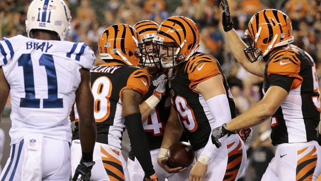 The Cincinnati Bengals celebrate an interception by inside linebacker Nick Vigil (59) in the second quarter of the NFL preseason Week 4 game between the Cincinnati Bengals and the Indianapolis Colts at Paul Brown Stadium in downtown Cincinnati on Thursday, Sept. 1, 2016.  At halftime, the score was tied at 0.