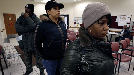 Welfare applicants wait in line at the Wayne County Family Independence Agency office in Detroit. More states have embraced drug-testing programs for welfare applicants, but they are taking new approaches due to a recent court ruling.
