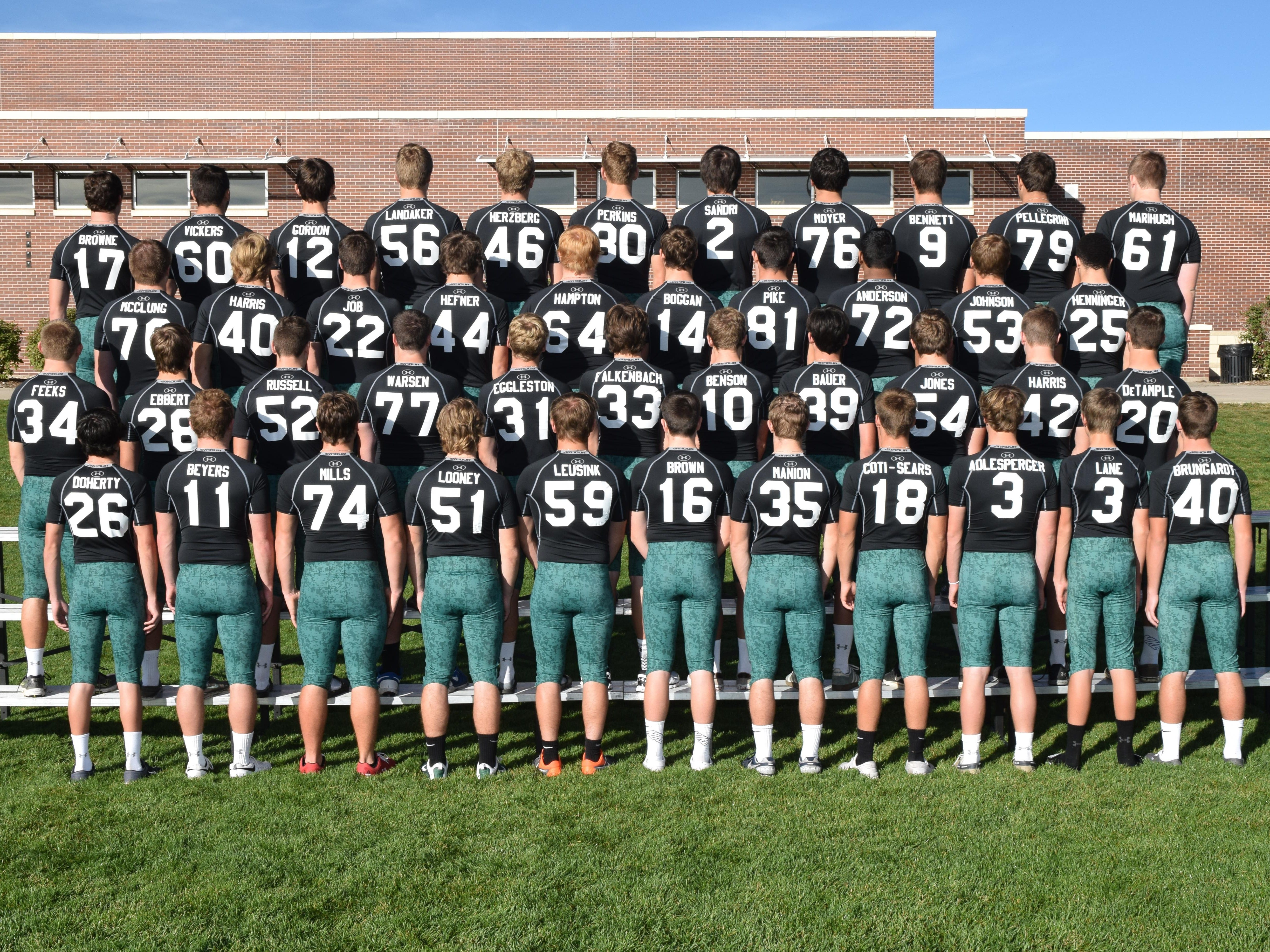 Members of the Fossil Ridge football team wear undershirts with the names of fallen soldiers they will be honoring during Thursday's game.