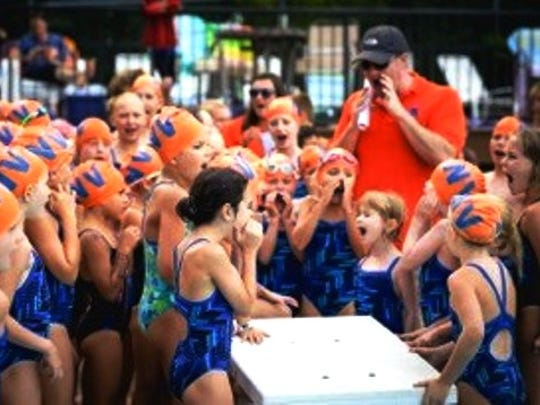 The Northville Swim Club coach Dave Rembiesa leads his youngest swimmers in a cheer.