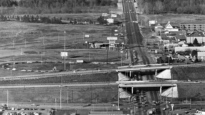 March 21, 1980 - Looking east out Summer Avenue in March 1980 shows an undeveloped area between White Station (foreground) and the Wolf River and beyond to the east. The bridges in foreground are I-240 East over White Station.