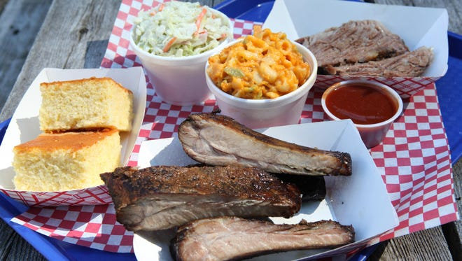 Roundup Texas Barbecue specialties that include ribs, brisket, coleslaw, mac and cheese and cornbread.