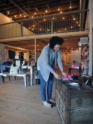 Kathryn Hager, owner of Little h Creative, adjusts