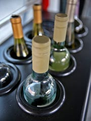 """Bottles of wine are cooled in the new mobile wine bar, """"Vinny"""" The Vino Mobile Bar, on a stop at The Urban Chalkboard, Thursday, June 9, 2016.  It's the first mobile wine bar launched by Carmel ÒmompreneurÓ Jenn Kampmeier."""