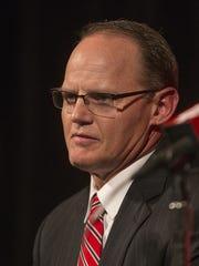 Indiana defensive coordinator Tom Allen accepts his