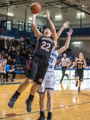 Marshall's Jill Konkle (22) goes for the layup during