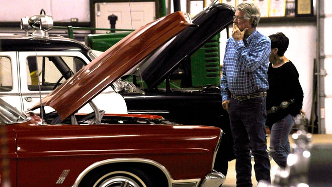 Zed Urban Bright and Betty Joy Vaught look over the vintage vehicles at the Merkel Area Historical Museum Friday. The museum hosted a chili supper for Texas Independence Day.