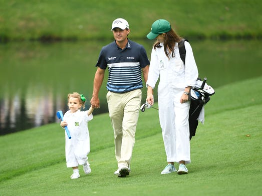 Kevin Kisner walks with daughter Kate and wife Brittany