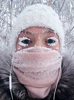 On Saturday, Jan. 13, 2018, Anastasia Gruzdeva poses for a selfie as the temperature dropped to about 58 degrees below zero in Yakutsk, Russia.