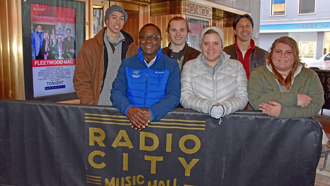 Students from Middle Tennessee State University's College of Media and Entertainment are in New York City for behind-the-scenes experience in support of events related to the 60th annual Grammy Awards celebration. Pictured Friday, Jan. 26, at Radio City Music Hall, from left, are Foster Riggs, senior; MTSU President Sidney A. McPhee; Michael Ryan May, senior; LB Rogers, senior; professor Matt Foglia; and Siara Strickland, senior.
