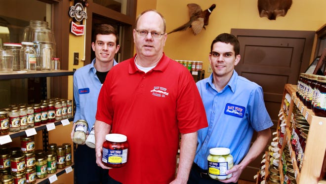 Reinhard Liebner (center), owner of Bay View Packing, with sons Andrew (left) and Eric.