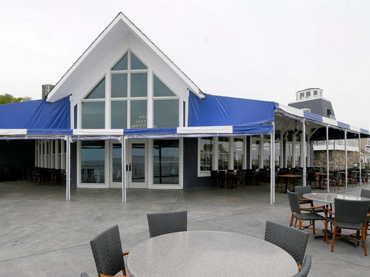 At Joe Amiel's Bay Pointe Inn in Highlands, the outdoor seating area overlooks a marina and Sandy Hook Bay.