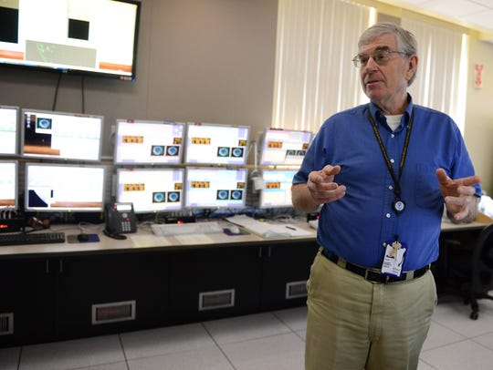 Albert McMath Jr., NOAA Operations Branch Chief, shows