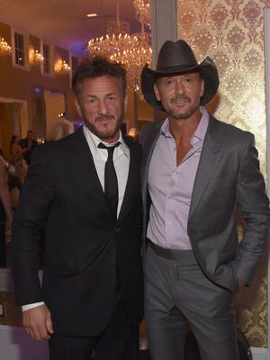 Actor Sean Penn, left, and singer-songwriter Tim McGraw attend Nashville Shines for Haiti benefiting Penn's J/P Haitian Relief Organization on Oct. 24, 2017, in Brentwood.
