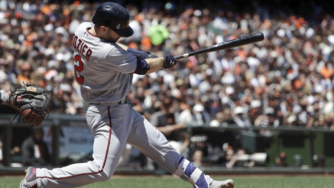 Minnesota Twins' Brian Dozier hits a two-run home run against the San Francisco Giants during the fifth inning of a game Saturday in San Francisco.