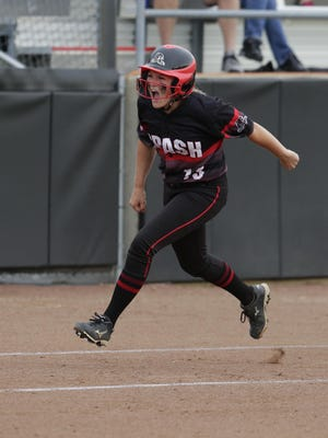 SPASH's Aubrey Drohner starts to celebrate as she approaches home plate after hitting a home run during their WIAA Division 1 quarterfinals game against Kenosha Tremper at Goodman Diamond in Madison.