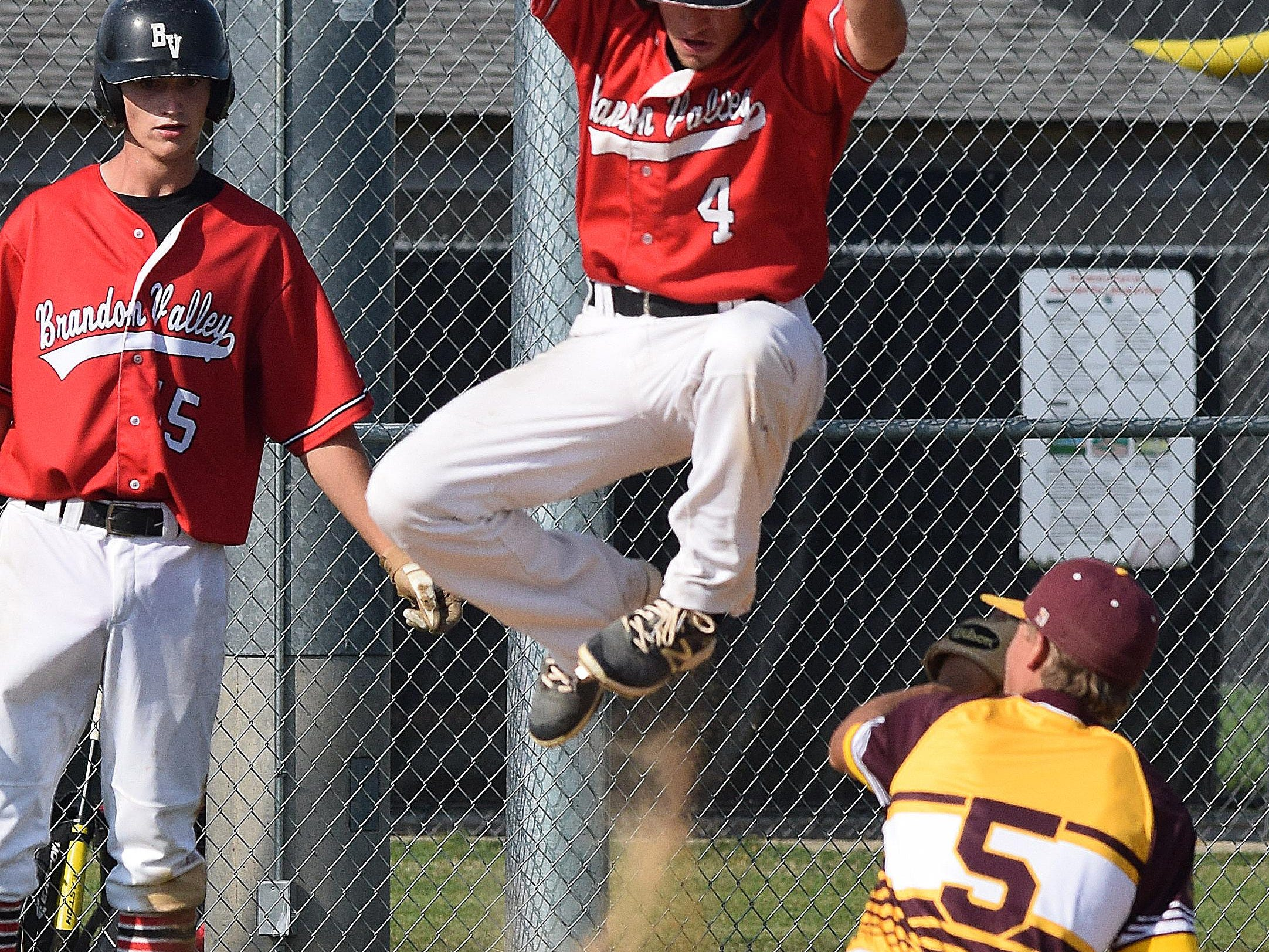 Despite being tagged out, Post 131's Calvin Kedik elevates himself over the Harrisburg player during Brandon Valley's 3-0 shutout in game two of the Region 2A American Legion Baseball Tournament last week.