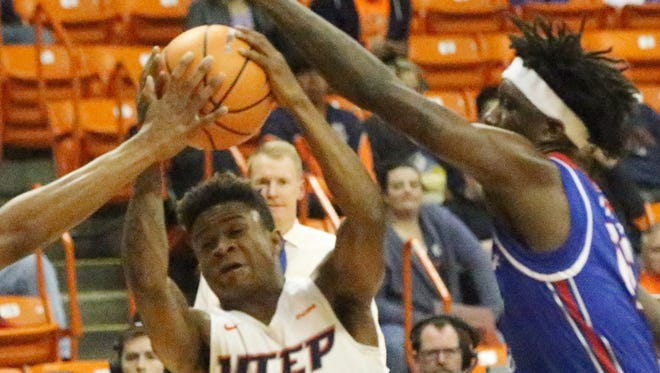Evan Gilyard of UTEP drives between two Louisiana Tech players while driving to the basket Thursday night.