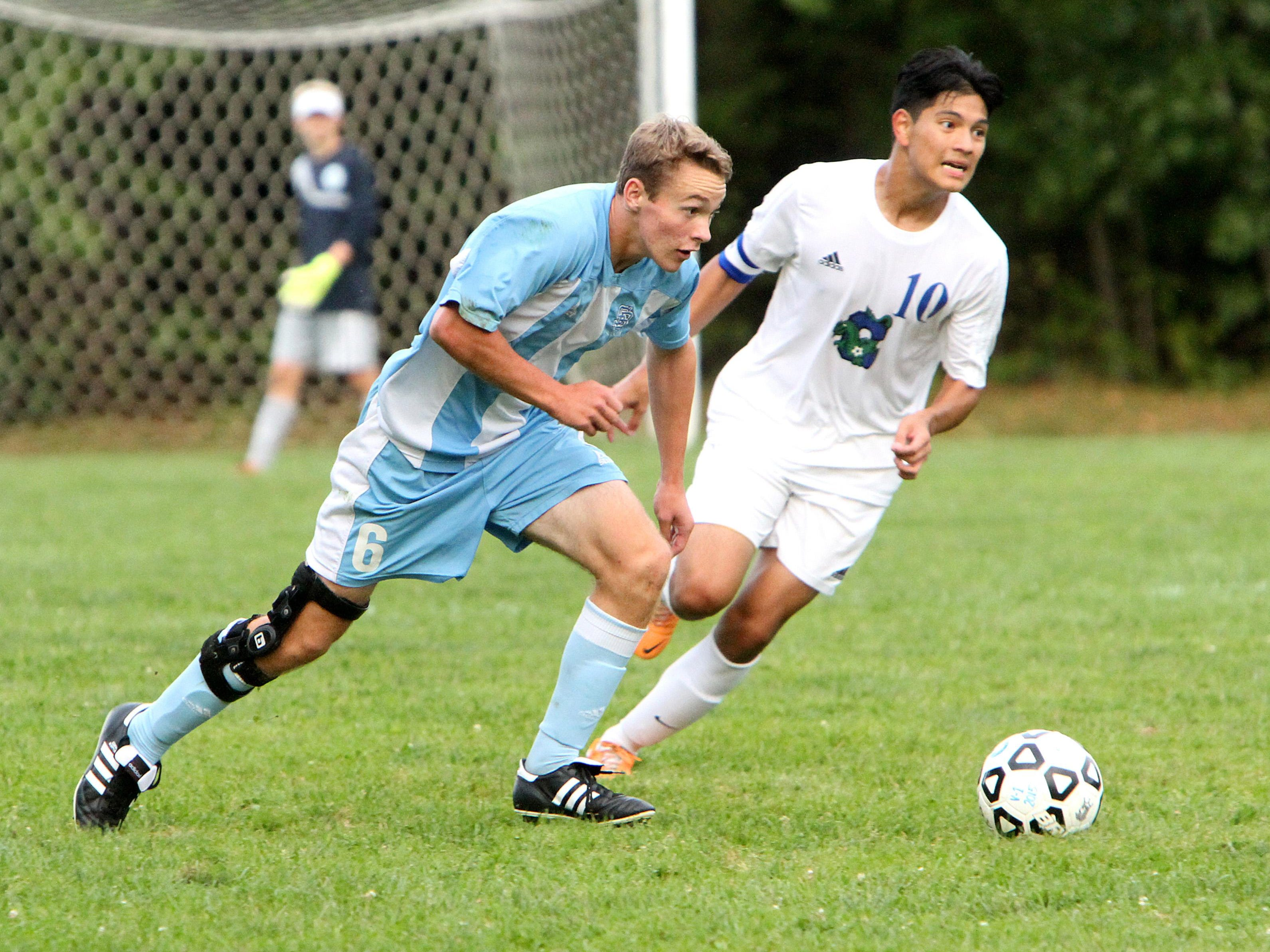 South Burlington's Patrick O'Hara looks up field for a teammate during the Rebels' 3-2 overtime win over Colchester. O'Hara scored the game winner with under five seconds left in overtime.