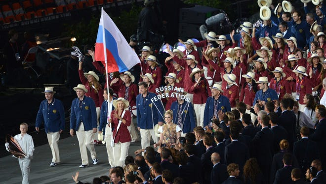 The Russian team, with flag bearer Maria Sharapova, is shown at the opening ceremony of the 2012 London Olympics.