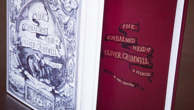 "At Marc Hartzman's Saturday appearance in Asbury Park, he will be selling signed and numbered copies of a limited edition of his ""The Embalmed Head of Oliver Cromwell: A Memoir."" They feature a special foil-stamped cover and unique endpapers with a reproduction of a 19th-century letter regarding the head."
