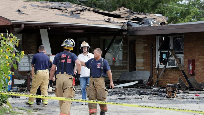 Firemen walk in front of the Embers Apartments, 3615 S. Business Drive, where an early morning fire Sunday August 21, 2016 killed one person.