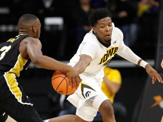 Iowa guard Isaiah Moss (right) tries to steal the ball