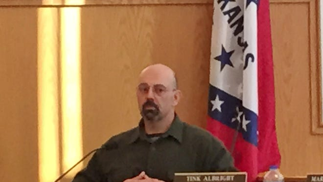 Paul Thinnes testifies at his grievance hearing.