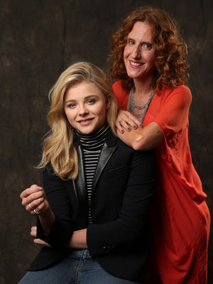 "Chloe Grace Moretz, star of the movie ""If I Stay"" and author Gayle Forman. The movie is based on Forman's novel of the same title, about a teenage girl in a coma after a car crash."