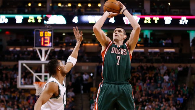 Milwaukee Bucks forward Ersan Ilyasova (7) shoots against Boston Celtics guard Evan Turner (11) in the second half at TD Garden. The Bucks defeated the Celtics 110 to 101.