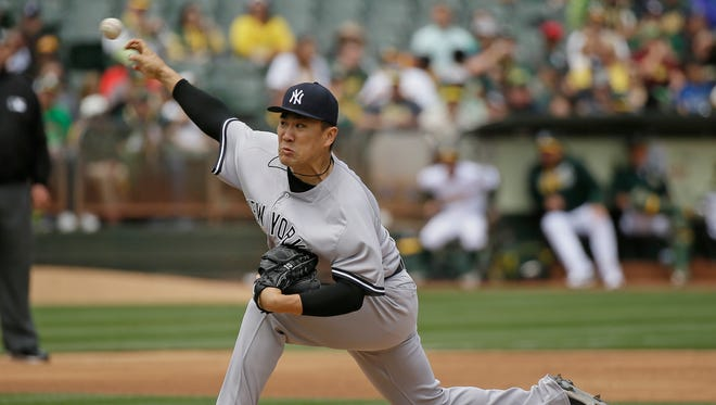 New York Yankees starting pitcher Masahiro Tanaka throws in the third inning of a baseball game against the Oakland Athletics, Saturday, May 21, 2016, in Oakland, Calif.