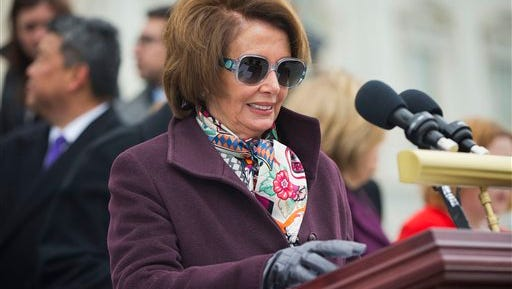House Minority Leader Nancy Pelosi of Calif. looks over her prepared remarks before speaking at an event to commemorate the fifth anniversary of President Obama signing into law the Affordable Care Act, Tuesday, March 24, 2015, on Capitol in Washington. (AP Photo/Pablo Martinez Monsivais)