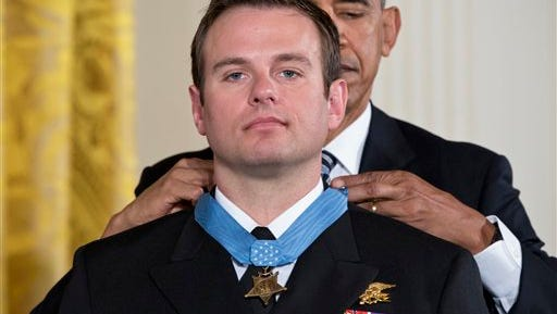 President Barack Obama presents the Medal of Honor to Senior Chief Special Warfare Operator Edward Byers during a ceremony in the East Room of the White House in Washington, Monday, February 29, 2016. Navy Senior Chief Byers is received the Medal of Honor for his courageous actions while serving as part of a team that rescued an American civilian being held hostage in Afghanistan on December 8-9, 2012.