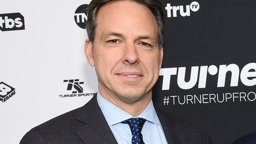 """FILE - In this May 18, 2016 file photo, CNN news anchor Jake Tapper attends the Turner Network 2016 Upfronts in New York. Tapper and CNN have both apologized for an on-screen banner Tapper said was """"unacceptable"""" and """"horrified"""" him when it appeared during his show on Monday, Nov. 21. The offending phrase appeared during a discussion between Jim Sciutto, subbing for Tapper on """"The Lead,"""" and two journalists about President-elect Donald Trump's support from the alt-right."""