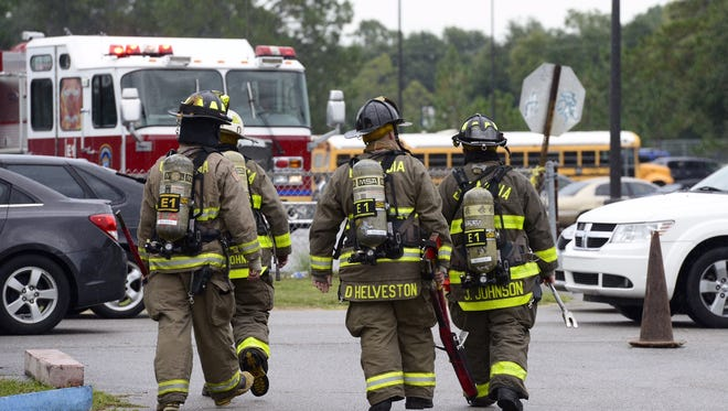 Firefighters respond to a possible gas leak at Pine Forest High School.