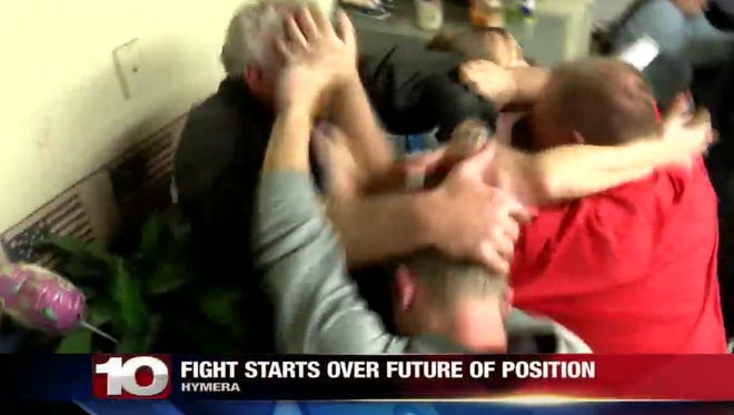 A screenshot of WTHI-TV video of the fight at the Hymera town board meeting.
