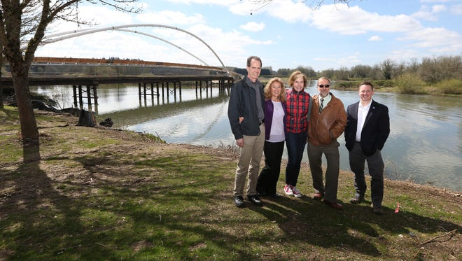Rotary Club of Salem and South Salem members John Shirley, left, Deb Wilding, Chane Griggs, Robert Chandler and Chad Campbell are photographed near the Peter Courtney Minto Island Bridge on Friday, March 31, 2017, at Riverfront Park. The Rotary Club is organizing a triathlon Oct. 1 that showcases the city's downtown parks and the new bridge.