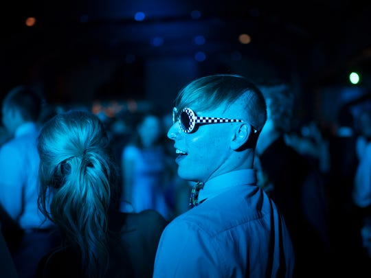 Grant Nosko needs shades at the Reitz High School Prom at Burdette Park's Discovery Lodge Saturday night.