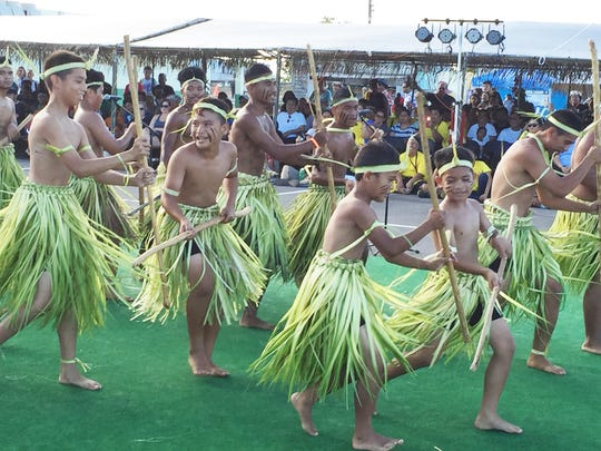 Dancers from the Mortlock Islands of Ettal, Chuuk, perform an ancient ritual used to prepare the men for battle at the Farmer's Co-Op in Dededo at the 2016 Festival of Pacific Arts  in this file photo. The Office of Insular Affairs faces the elimination of $4 million in discretionary compact-impact assistance for Guam and other affected jurisdictions.