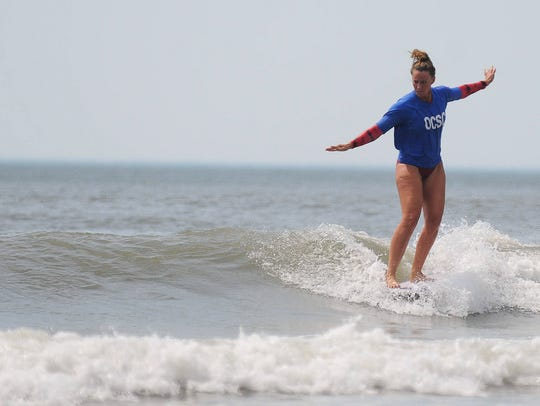 Leigh Powell competes in the 15th Annual Walk Da Plank Pro Invitational Longboard contest hosted by the Ocean City Surf Club.