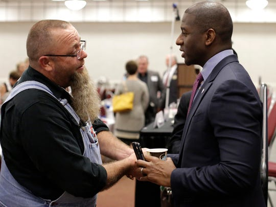 Mayor Andrew Gillum (right) talks to Greg Marr Jr. after speaking at the May 31 meeting of theTiger Bay Club at the Tucker Civic Center.