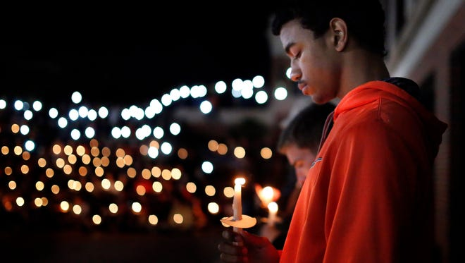 Oklahoma State University freshman Bryce Jones attends a vigil on campus Sunday, Oct. 25, 2015, in Stillwater, Okla. A woman faces second-degree murder charges after authorities said she plowed a car into the crowd at an Oklahoma State homecoming parade on Saturday, killing multiple people, including a toddler.